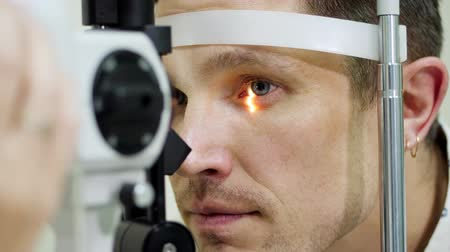 intraocular : face close-up , man doing eye test with non contact tonometer, cheking vision, intraocular pressure at optical clinic, ophthalmilogical laboratory Stock Footage