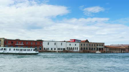 burano : VENICE, ITALY - JULY 7, 2018: view from the sea to the Venetian islands. blue sea, sky, summer day. Burano Island, Murano Island, San Michele Island, San Giorgio Maggiore Island, San Servolo Island, St. George Island, Torcello Island