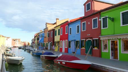 burano : VENICE, BURANO, ITALY - JULY 7, 2018: colorful architecture of the island of Burano. Many colorful houses, boats along a small canal. Stock Footage
