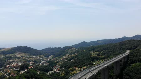 amalfitana : large bridge, an autobahn , highway towering over a cliff, connecting two mountains. Active movement on the bridge. In the highlands of Italy, Stock Footage