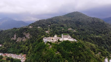 padre : BIELLA, ITALY - JULY 7, 2018: aero View of beautiful Shrine, ancient temple complex, big castle, sanctuary located in mountains near the city of Biella, Piedmont, Italy. summer