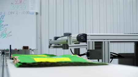 plakát : CHERKASY, UKRAINE - AUGUST 24, 2018: on conveyor belt, already printed packages for grain, agricultural products leave. printing process. production, in the workshop