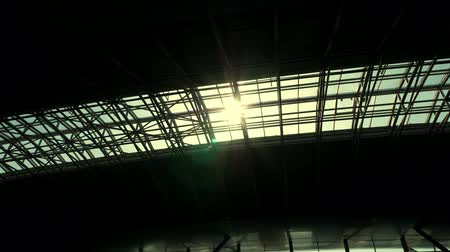 rendes : the sun shines through the roof of the airport pavilion Stock mozgókép