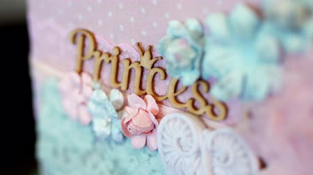 koronka : close-up. beautiful inscription princess, decorated with lace and flowers made of fabric. in peach tones Wideo