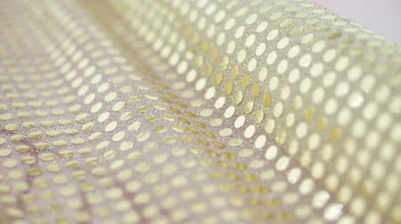 mais : close-up fabric with gold sparkles Stock Footage