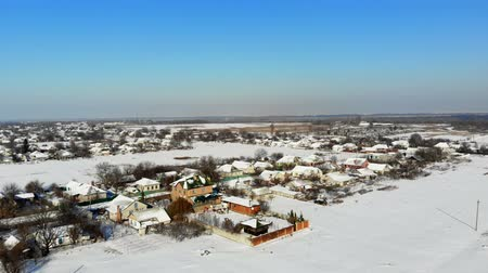 neighbor : CHERKASY REGION, UKRAINE, DECEMBER 25, 2018: winter, snow-covered streets, houses. frosty sunny day. aero, view from above. Stock Footage