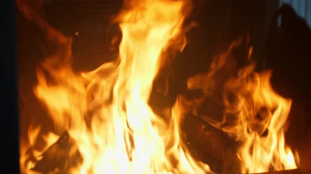 aglow : close-up, fireplace with wood in the house, the family is heated by the fire, fireplace. fire in the fireplace Stock Footage