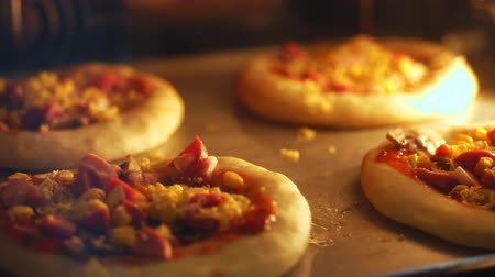 kuşkonmaz : close-up, the process of baking mini pizza from yeast dough in a large industrial oven. Baking bread in an industrial restaurant kitchen or bakery using a commercial oven.