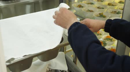 готовые к употреблению : close-up, workers hands take bread, cutlery, napkins in the self-service canteen. dining room for the workers of a large enterprise, factory.