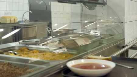 pronto a comer : close-up, showcase with dishes in modern Self service canteen, cafeteria, restaurant of public catering, mess hall,