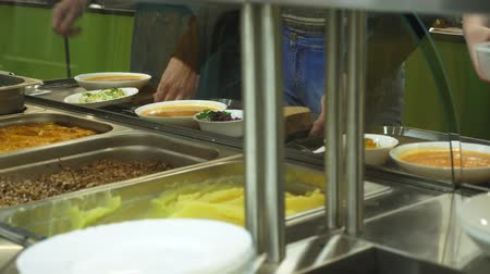 столовая : close-up, showcase with dishes in modern Self service canteen, cafeteria, mess hall, factory employees having lunch in the canteen, they are Served Meal In factory Canteen