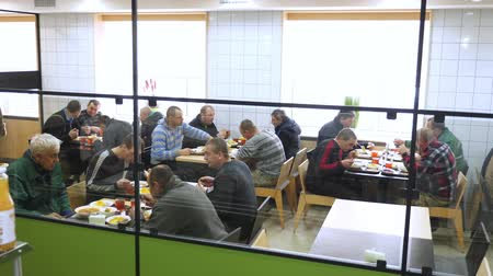 canteen : CHERKASY, UKRAINE, FEBRUARY 20, 2019: visitors, workers at the enterprise have lunch in a modern factory canteen, cafeteria, mess hall, Self service restaurant Stock Footage