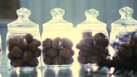 step : close-up, stored in glass jars are seeds, walnuts, various species grown on breeding, hybrids of nuts. nuts of the best quality. nut for pedigreed horses.