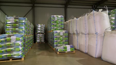 brown rice : large warehouse for grain storage, grain products such as corn, sunflower are in jumbo bags and packages