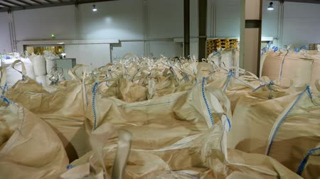 empilhados : large warehouse for grain storage, grain products such as corn, sunflower are in jumbo bags and packages