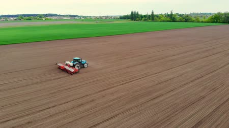 есть : aerial survey, spring, a tractor with special precision planters is working in the field, there is a planting of corn, or sunflower. planting season on the farm. modern technologies in agriculture.