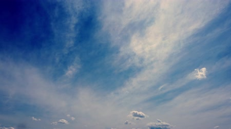 ozón : timelapse, white, beautiful clouds are running against the blue sky.