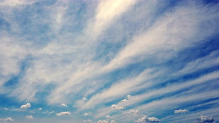 озон : timelapse, white, beautiful clouds are running against the blue sky.