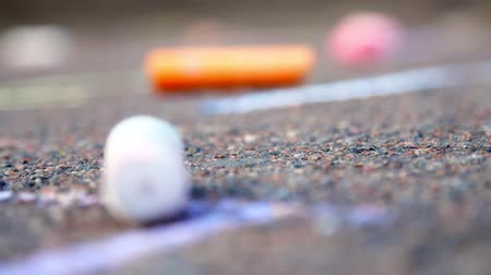 close-up, colored crayons lie on the pavement