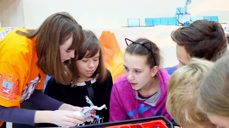 CHERKASY, UKRAINE, OCTOBER 19, 2019: school children, boys and girls, work with a designer, create various machines, robots of designer non-ferrous parts, blocks. School of Robotics, STEM education.
