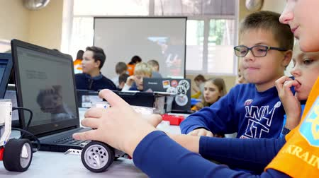 CHERKASY, UKRAINE, OCTOBER 19, 2019: students create devices using the designer, according to the instruction in the laptop . School of Robotics, STEM education