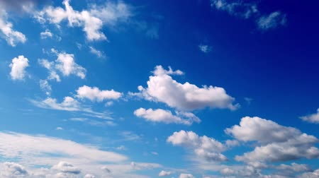 tlen : timelapse, white, beautiful clouds are running against the blue sky.