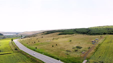 erdély : aero shooting. panoramic view of green fields, valleys, coniferous forest, automobile highway. Transylvania, Romania, Europe. beautiful summer landscape,
