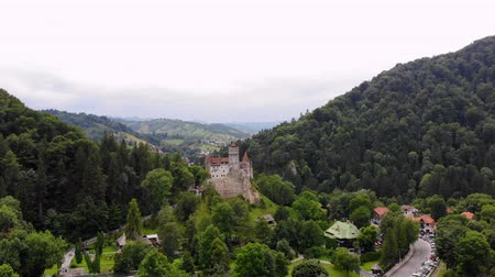 korpa : aero. panoramic view of the ancient Bran castle on a hill , Dracula Castle, Transylvania, Brasov, Romania. at the foot of the castle there is a small town. summer day Stock mozgókép