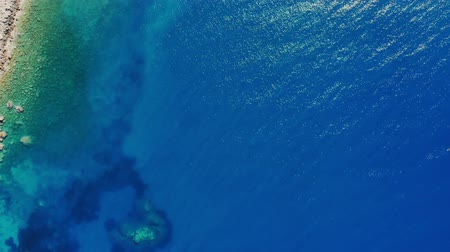aegean sea : aero, top view. The turquoise blue waters of the Aegean in the sunlight. coastline.