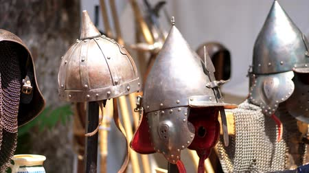 historical reconstruction : close-up, knights helmets, chain mail, armor.