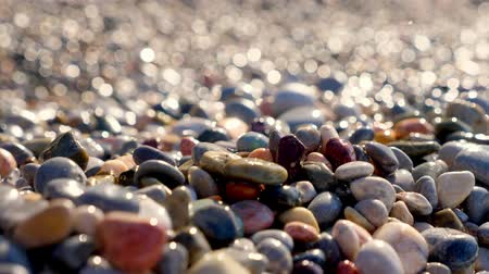 seixo : Close-up. pebble beach. beautiful, multi-colored round sea pebbles on the shore of the Mediterranean Sea. summer sunny day. Greece