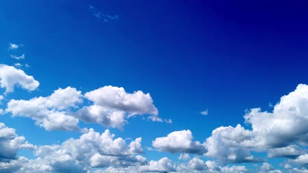 tlen : timelapse, white, beautiful airy clouds are running against the blue sky.