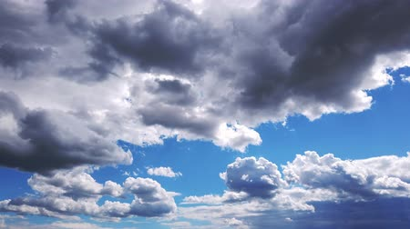 meteoroloji : timelapse, white, beautiful clouds are running against the blue sky.