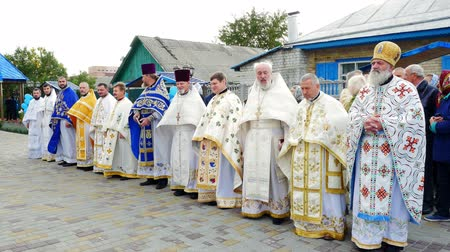 fiel : CHERKASY REGION, UKRAINE, OCTOBER 10, 2019: priests meet His Beatitude Metropolitan Epiphany. Preparation for consecration of newly built Church of the Blessed Virgin Assumption Stock Footage