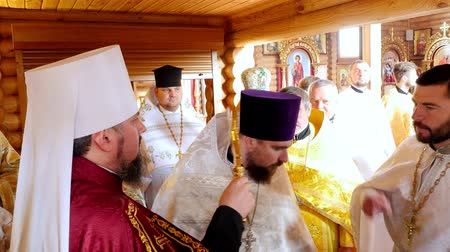 fiel : CHERKASY REGION, UKRAINE, OCTOBER 10, 2019: priests meet His Beatitude Metropolitan Epiphany and kiss his cross . Preparation for consecration of newly built Church of the Blessed Virgin Assumption in Chervona Sloboda village, Cherkasy region.