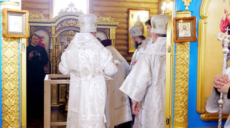 holy book : CHERKASY REGION, UKRAINE, OCTOBER 10, 2019: church ceremony. the rite of consecration of newly built Church of the Blessed Virgin Mary Assumption by Metropolitan Epiphany, the head of the united local Ukrainian Orthodox Church Stock Footage