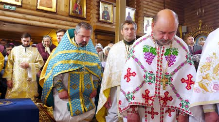 CHERKASY REGION, UKRAINE, OCTOBER 10, 2019: priests pray, church ceremony, consecration rite of newly built Church by Metropolitan Epiphany, head of united local Ukrainian Orthodox Church
