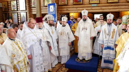 holy book : CHERKASY REGION, UKRAINE, OCTOBER 10, 2019: priests pray, church ceremony, consecration rite of newly built Church by Metropolitan Epiphany, head of united local Ukrainian Orthodox Church