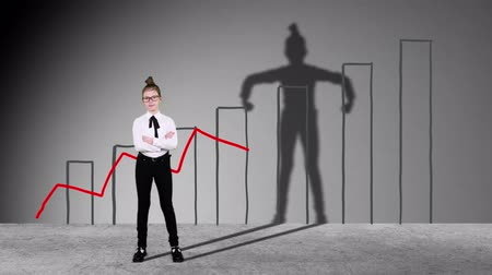 čmáranice : Smart Teenager girl pretends to be businessman, super hero with successful ideas. Imagination and motivation , start up, business idea concept. growing drawn graphics background. dancing shadow on wall. Dostupné videozáznamy