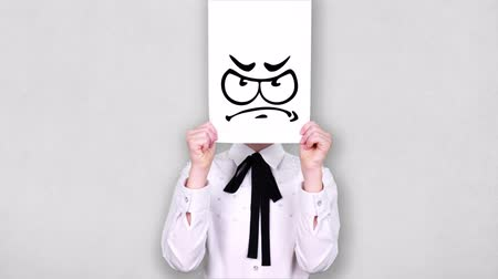 карикатура : portrait, teenager holds white paper sheet with disappointed smiley drawing, animation, covering face. emotions, Imagination, creativity, successful idea concept.