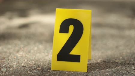 investigar : Closeup of Yellow Crime Scene Marker
