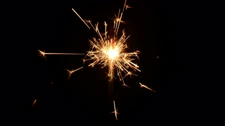 double happiness : Burning christmas sparklers isolated on a black background Stock Footage