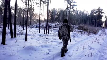 commando : Hunters in the Woods. Armed Rangers in winter forest