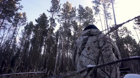 aim : Hunters in the Woods. Armed Rangers in winter forest