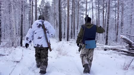 orvlövész : Two Hunters in the Woods. Armed Rangers in winter forest