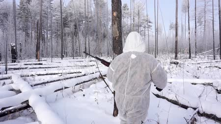 presa : Hunters in the Woods. Armed Rangers in winter forest