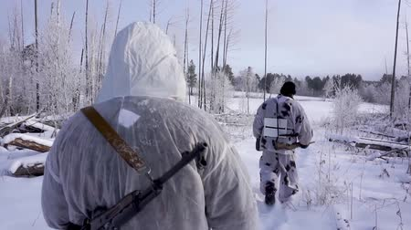 presa : Two Hunters in the Woods. Armed Rangers in winter forest