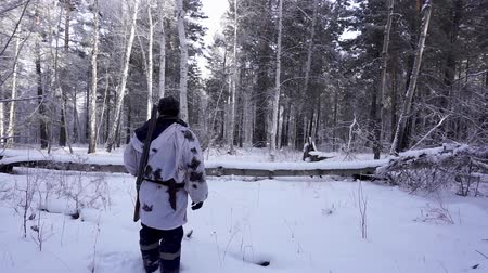 фокус : Hunters in the Woods. Armed Rangers in winter forest