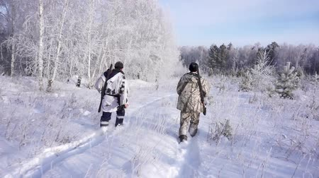 infantry : Two Hunters in the Woods. Armed Rangers in winter forest