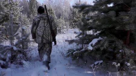 snajper : Hunters in the Woods. Armed Rangers in winter forest